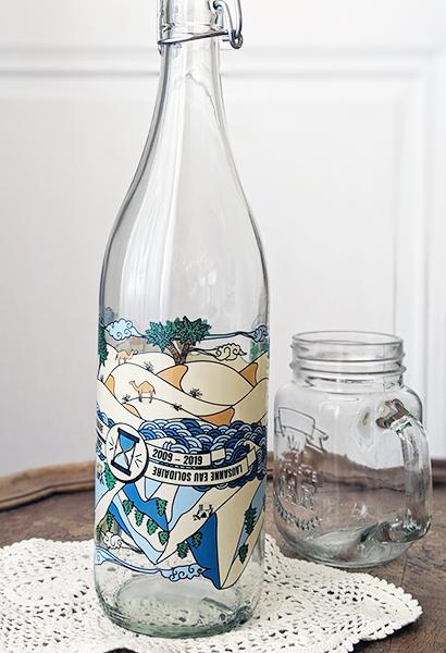 Glaswasserflasche Ville de Lausanne ©lausanneeausolidaire.ch